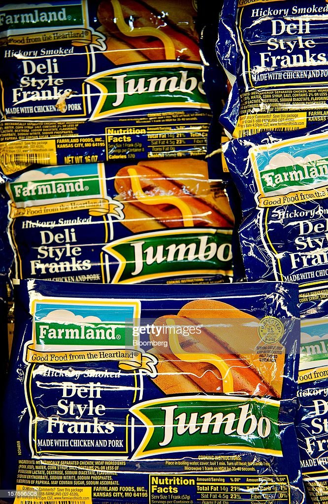 Smithfield Foods Inc. Farmland brand deli style franks sit on display at a supermarket in Princeton, Illinois, U.S., on Monday, Dec. 3, 2012. Smithfield Foods Inc., the world's biggest pork processor, is scheduled to report quarterly earnings on Dec. 6. Photographer: Daniel Acker/Bloomberg via Getty Images