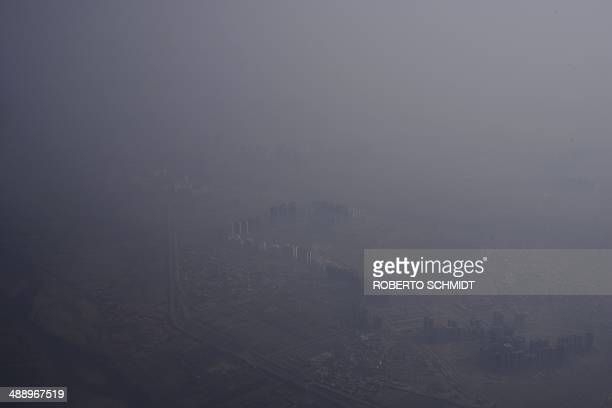 Smog covers buildings in New Delhi in this aerial photo on May 8 2014 India's state air monitoring centre made a rare admission on May 8 that...