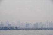Smog covers the skyline of Makati central business district on May 31 2013 in Manila Philippines