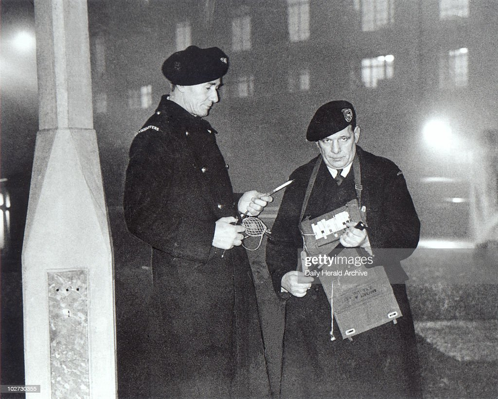 Smog wardens, London,1955. Smog wardens taking chemical readings at Blackfriars in London on 1 December 1955. The original caption reads: 'Two of London's smog wardens, called out for the first time yesterday, check the fog's thickness at Blackfriars.'