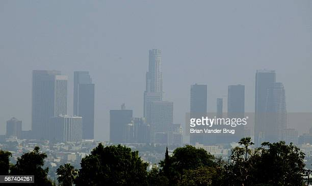 A smoggy hazy Los Angeles skyline Thursday afternoon 4/15/04The Bush administration's new rules for curbing smog will postpone a deadline for...