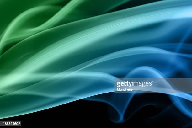 Fumée abstraite dans les zones verte et bleue