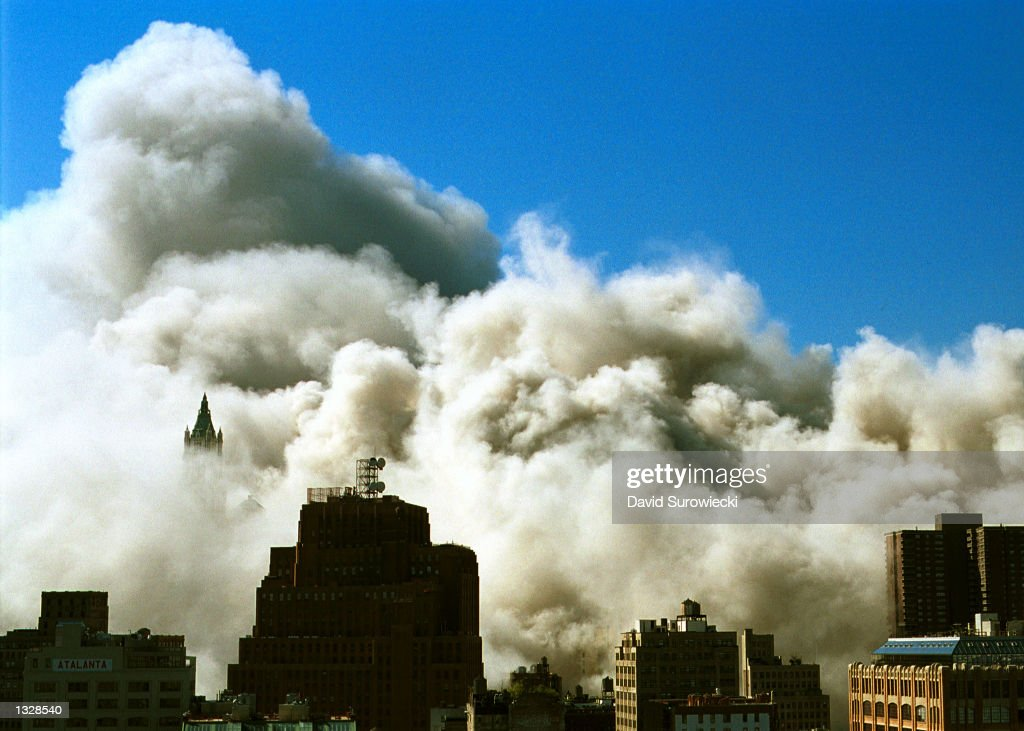 Smoke and ash covers southern Manhattan immediately after the collapse of the north tower of the World Trade Center September 11, 2001 in New York City after the towers were struck by two planes during a suspected terrorist attack.