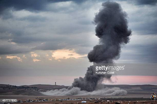 Smoke and dust rise over Syrian town of Kobani after an airstrike as seen from the Mursitpinar crossing on the TurkishSyrian border in the...