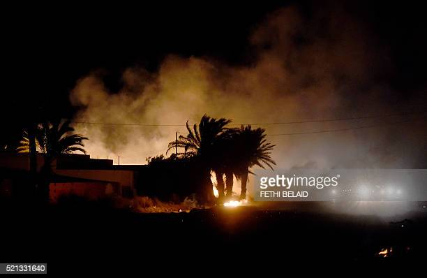 Smoke and fire billow during clashes between Tunisian security forces and residents of the island of Kerkennah on April 14 2016 over social protests...