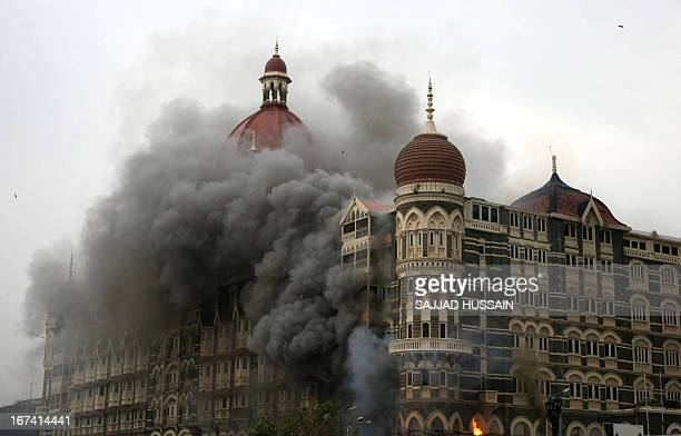 Smoke and flames billow out from The Taj Mahal hotel in Mumbai on November 29 2008 Indian commandos have killed the last Islamic militants holed up...