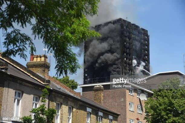 Smoke and flames billows from Grenfell Tower as firefighters attempt to control a blaze at a residential block of flats at Ladbroke Grove London...