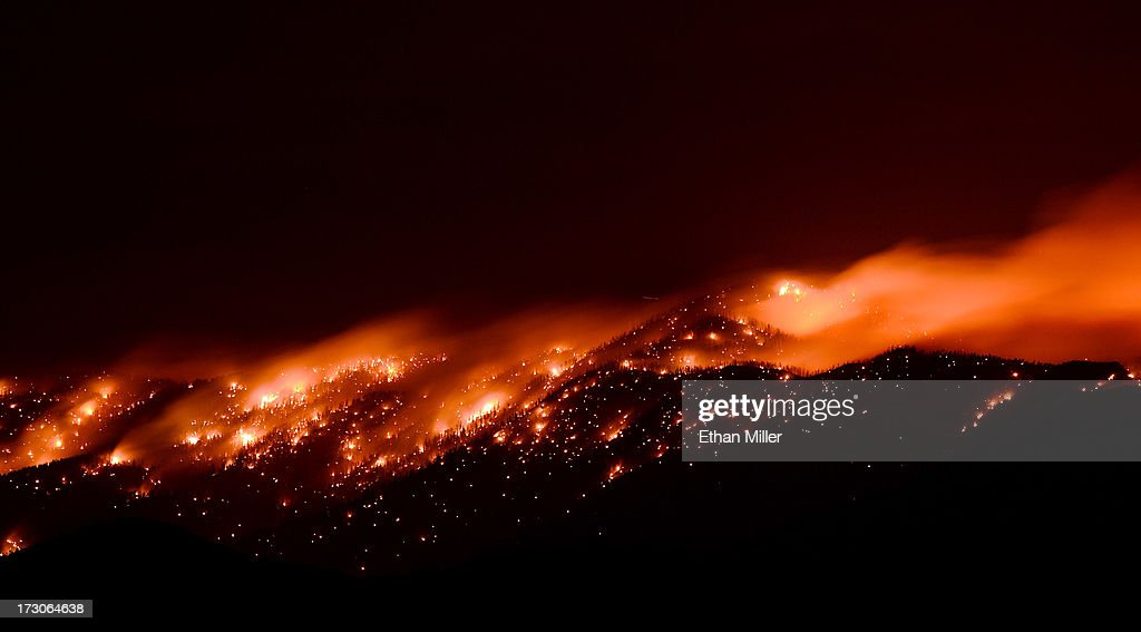 Smoke and flames from the Carpenter 1 fire are seen along a ridgeline in the Spring Mountains range early on July 6, 2013 in the Spring Mountains National Recreation Area, Nevada. More than 9,000 acres have burned since lightning sparked the blaze in Carpenter Canyon on the Pahrump, Nevada side of Mount Charleston on Monday. More than 400 firefighters are battling the as yet uncontained wildfire which crested the peak of Mount Charleston on Thursday, prompting the evacuation of 520 people as it began descending the east side of the mountain, about 35 miles northwest of Las Vegas.