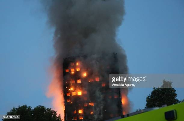 Smoke and flames rise from a 27storey apartment building near Nothing Hill in London United Kingdom on June 14 2017 At least 40 fire engines and more...
