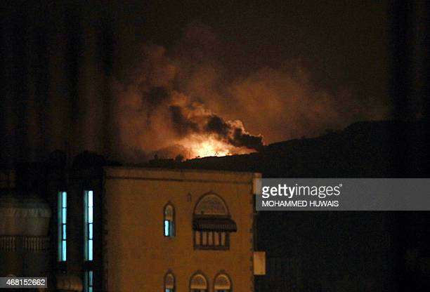 Smoke and flames rise from an alleged weapons storage depot at a Shiite Huthi rebel camp after an airstrike by the Saudiled alliance on March 30 2015...