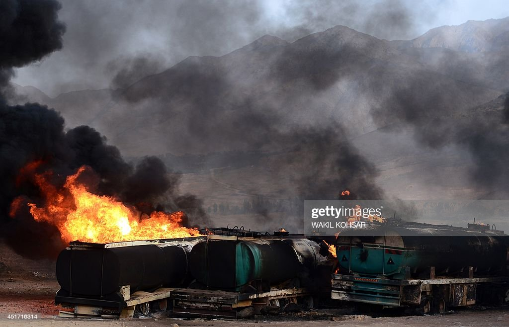 Smoke and flames rise from buring fuel trucks following an overnight attack by Taliban militants in ChawkeArghandi on outskirts of the Afghan capital...