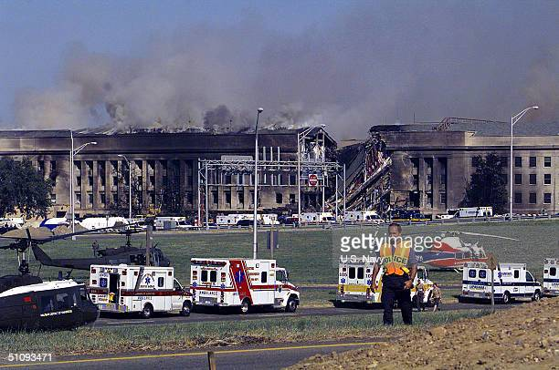 Smoke And Flames Rise Over The Pentagon At About 10 AM Est September 11 2001 Following A Suspected Terrorist Crash Of A Hijacked Commercial Airliner...