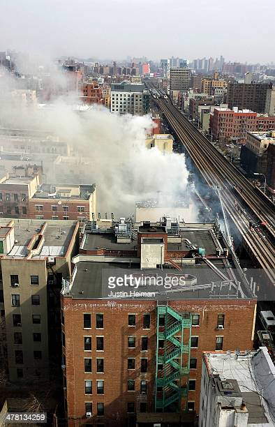 Smoke and steam rises from the scene as firefighters from the Fire Department of New York respond to a 5alarm fire and building collapse at 1646 Park...