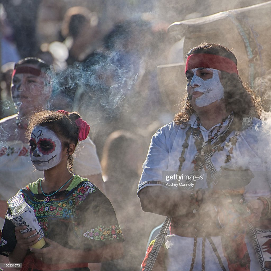 CONTENT] Smoke Bearers dressed in Calavera style bless the beginning of the annual Marigold Parade which takes place in the South Valley of Albuquerque, New Mexico each year honoring Dias De Los Muertos.