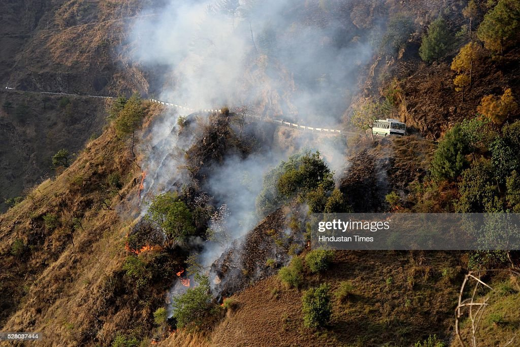 Smoke belching out of the jungles in Mandi district, on May 3, 2016 in Himachal Pardesh, India. After Uttarakhand and Himachal, forest fires reported from Bathuni and Gambhir in Rajouri, J&K. The worst hit areas in Himachal include popular tourist attractions like Solan, Sirmour, Shimla and Mandi.