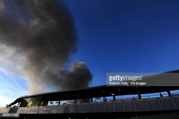 Smoke bellows from a fire in Stratford east London Firefighters are dealing with a blaze today in Waterden Road Stratford an industrial area of east...