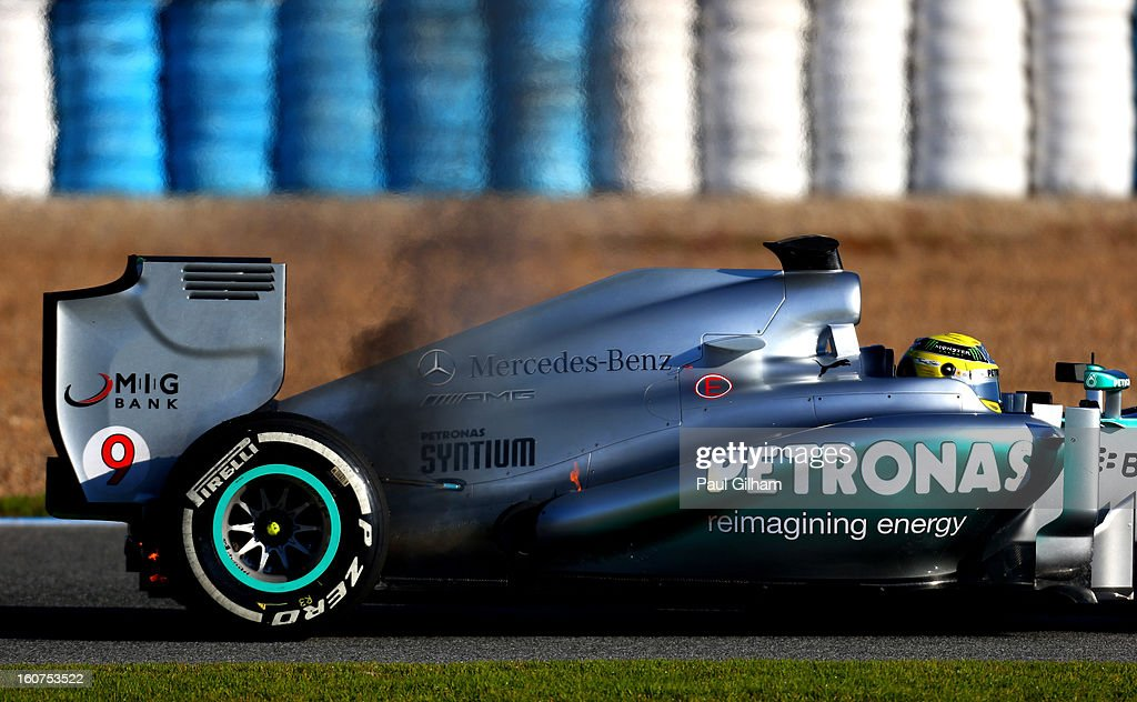 Smoke bellows from the W04 belonging to Nico Rosberg of Germany and Mercedes GP during Formula One winter testing at Circuito de Jerez on February 5, 2013 in Jerez de la Frontera, Spain.