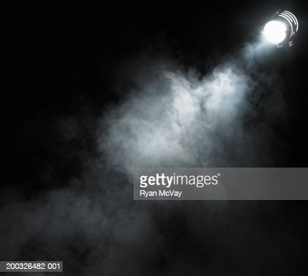 Smoke beneath spotlight