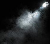 Smoke beneath spotlight
