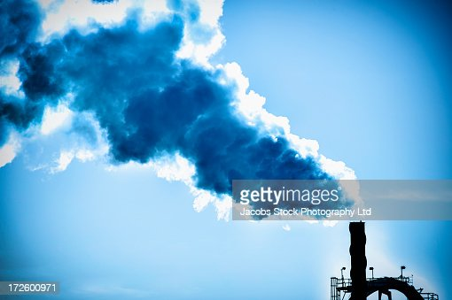 Smoke billowing from factory smoke stack : Stock Photo