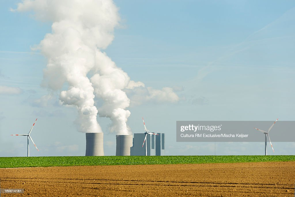 Smoke billowing from power plant : Stock Photo