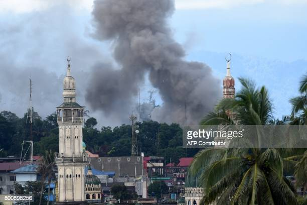 Smoke billows after aerial bombings by Philippine Airforce planes on Islamist militants' positions in Marawi on the southern island of Mindanao on...