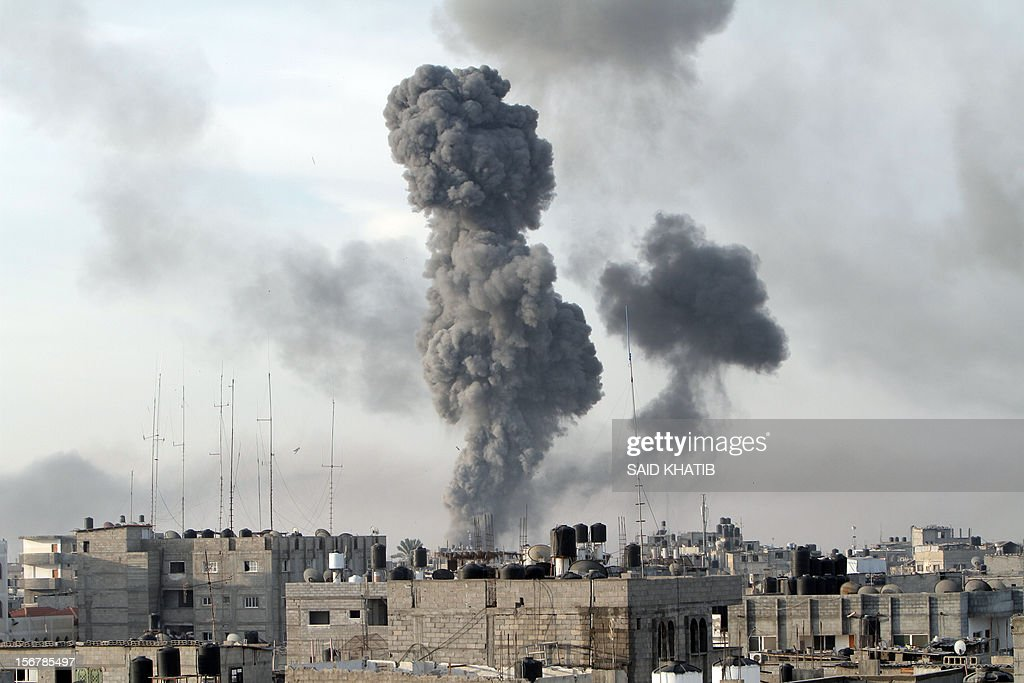 Smoke billows after Israeli air strikes near smuggling tunnels between the southern Gaza Strip and Egypt, on November 21, 2012 in Rafah. Fighting raged on both sides of Gaza's borders Wednesday despite intensified efforts across the region to thrash out a truce to end a week of violence that has cost 136 Palestinian and five Israeli lives.