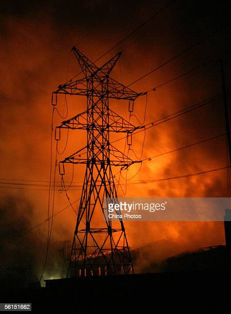 Smoke billows and fire burns at the Jilin Petroleum and Chemical Company after explosions November 13 2005 in Jilin City some 100 km east from...