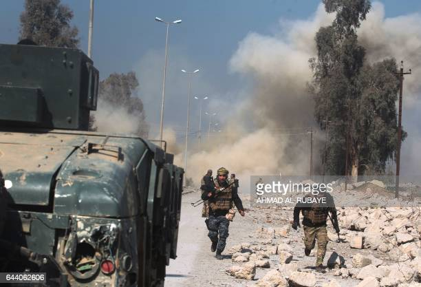 TOPSHOT Smoke billows as Iraqi forces attack Mosul airport during an offensive to retake the western side of the city from jihadists of the Islamic...
