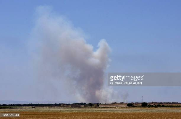 Smoke billows as Syrian government forces battle the Islamic State group on May 16 2017 in the town of Maskana on the edge of Lake Assad in the...