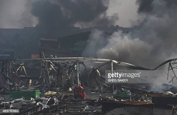 Smoke billows at the site of a series of explosions in Tianjin northern China on August 13 2015 A series of massive explosions at a warehouse in the...