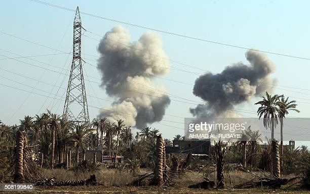 Smoke billows following a reported air strike by the USled coalition on February 3 2016 in the area of alSajariyah area east of the city of Ramadi...