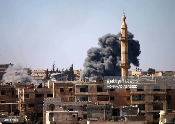 Smoke billows following a reported air strike on a rebel position during clashes between rebel fighters and Syrian progovernment forces to take...