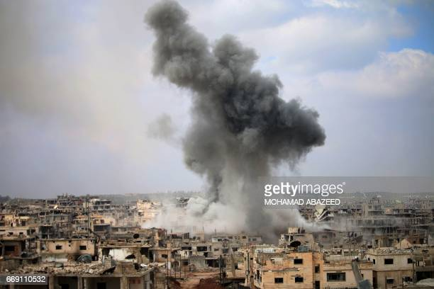 Smoke billows following a reported air strike on a rebelheld area in the southern Syrian city of Daraa on April 16 2017 / AFP PHOTO / Mohamad ABAZEED