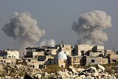 Smoke billows following a reported airstrike by government forces in the northern Syrian city of Aleppo on November 7 2015 More than 250000 people...