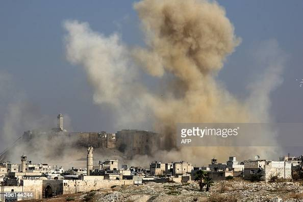 Smoke billows following a reported airstrike by government forces next to the Aleppo Citadel in the northern Syrian city on November 7 2015 More than...