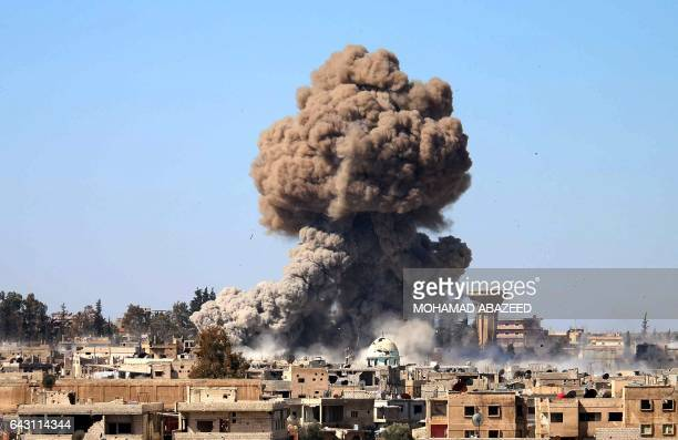 CORRECTION Smoke billows following a reported car bomb explosion at a Syrian progovernment position during clashes between rebel fighters and regime...