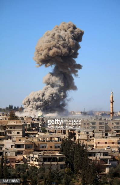 Smoke billows following a reported car bomb explosion at a Syrian progovernment position during clashes between rebel fighters and regime forces to...