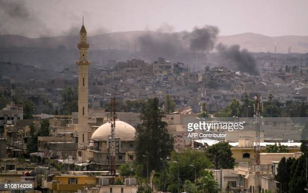 Smoke billows following an air strike in the Old City of Mosul as Iraqi government forces battle Islamic State group jihadists on July 8 2017 / AFP...