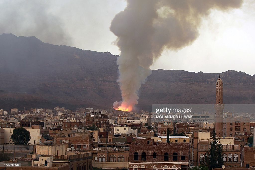 Smoke billows following an airstrike by Saudiled coalition on May 11 in the capital Sanaa The raid targeted an arms depot in the Mount Noqum area on...