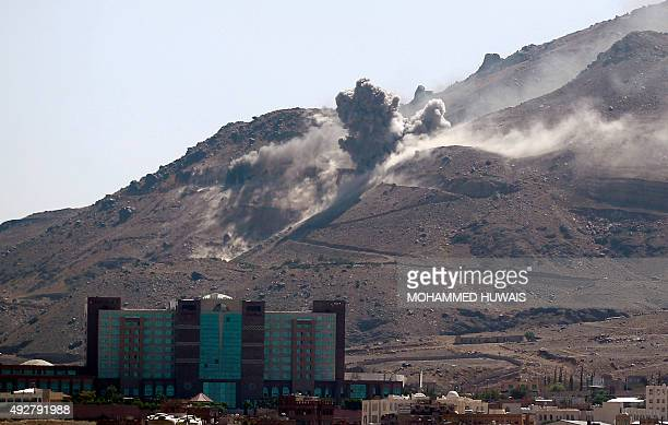 Smoke billows following an airstrike by the Saudiled coalition targeting an arms depot on the Nuqom mountain overlooking in the Yemeni capital Sanaa...