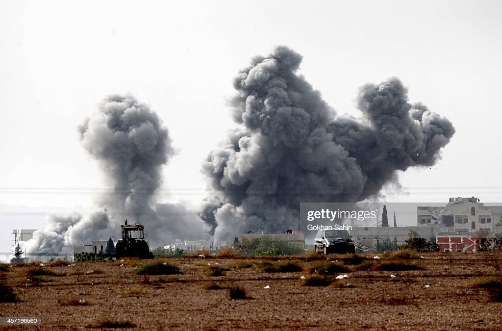 Smoke billows following an airstrike by USled coalition aircraft in Kobani Syria during fighting between Syrian Kurds and militants from Islamic...