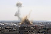 Smoke billows following an Israeli air strike in Rafah in the southern Gaza Strip on August 08 2014 The Israeli army carried out strikes on militant...
