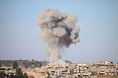 Smoke billows following reported air strikes by Syrian government forces in a rebelheld area of Daraa in southern Syria on February 17 2016 / AFP /...