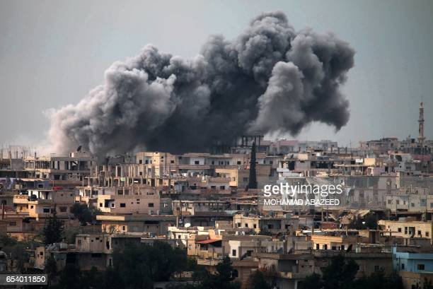 Smoke billows following reported air strikes on a rebelheld area in the southern city of Daraa on March 16 2017 Daraa province the cradle of the 2011...