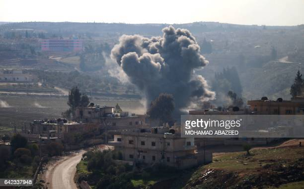 Smoke billows from a rebelheld area of Daraa in southern Syria following reported shelling by Syrian progovernment forces on February 17 2017 / AFP /...