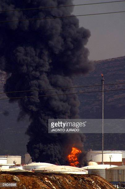 Smoke billows from a RepsolYPF petrochemicals complex following an explosion in Puertollano 230 kilometers south of Madrid 14 August 2003 Three...