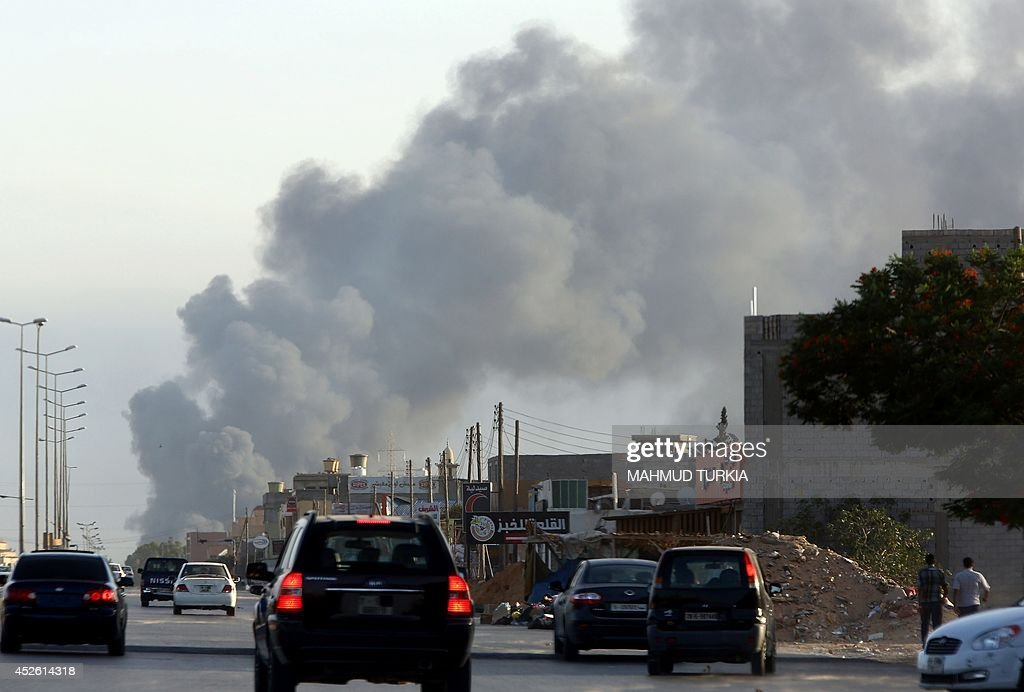 Smoke billows from an area near Tripoli's international airport as fighting between rival factions around the capital's airport continues on July 24...