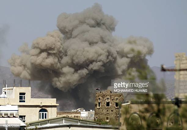 Smoke billows from buildings after reported air strikes by the Saudiled coalition on arms warehouses at AlDailami air base on September 29 north of...