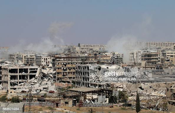 TOPSHOT Smoke billows from buildings during an operation by Syrian government forces to retake control of the rebelheld district of Leramun on the...